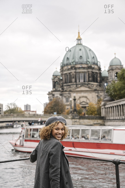 Happy tourist woman in the city at Spree river- Berlin- Germany