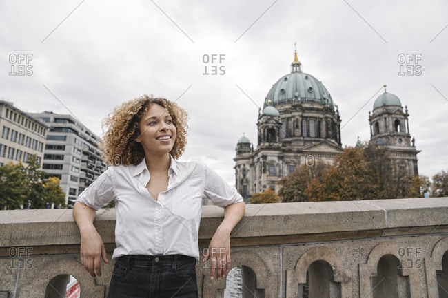 Tourist woman in the city with Berlin Cathedral in background- Berlin- Germany