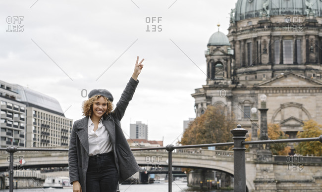 Portrait of cheerful tourist woman in the city with Berlin Cathedral in background- Berlin- Germany