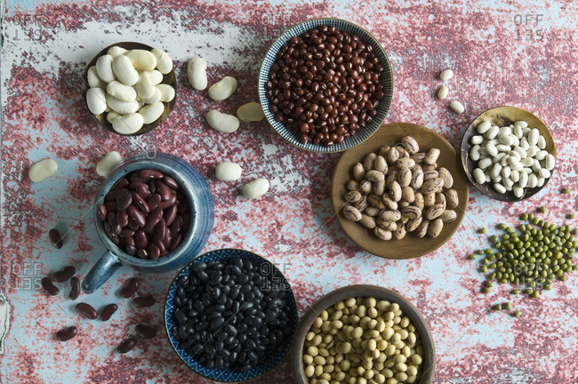 Directly above shot of various beans on table in kitchen
