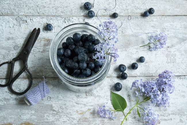 Directly above shot of blueberries in jar on wooden table
