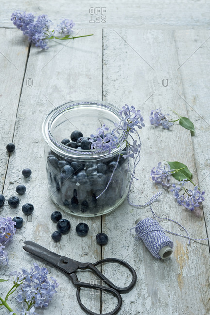 High angle view of blueberries in jar on wooden table