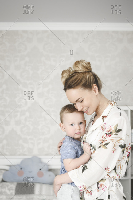 Mother with her little boy in the bedroom