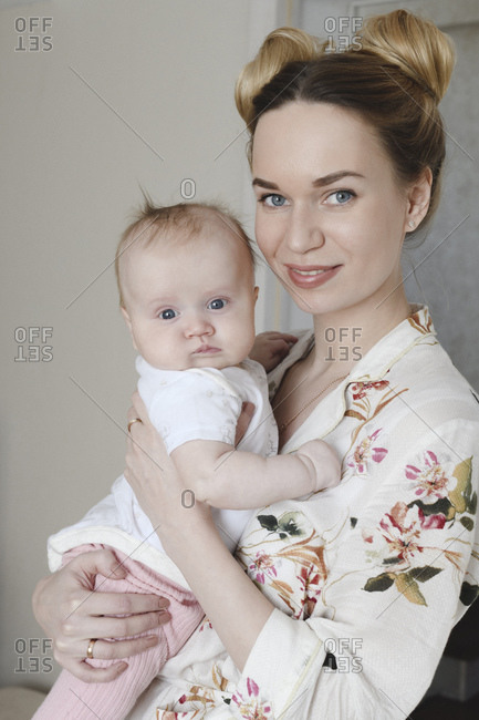 Portrait of mother with her cute baby at home
