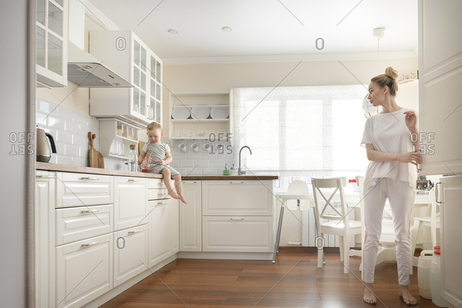 Mother with her little boy in the kitchen