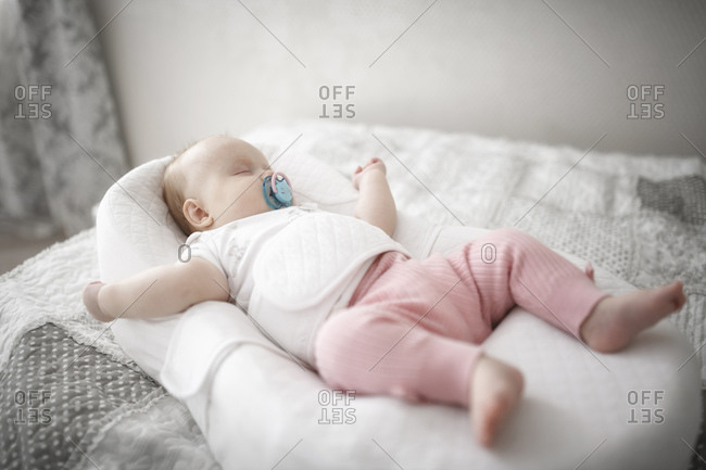 Cute baby girl sleeping on the bed