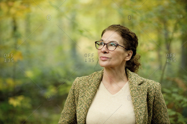 Portrait of a mature woman in a autumn forest