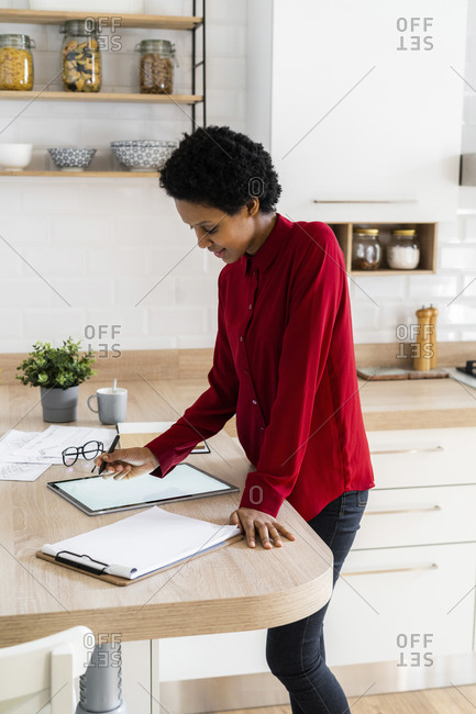Young woman using graphics tablet at home