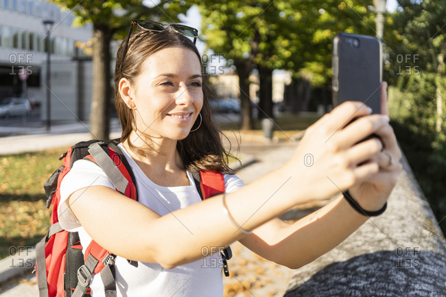 Young female backpacker taking a selfie in the city- Verona- Italy