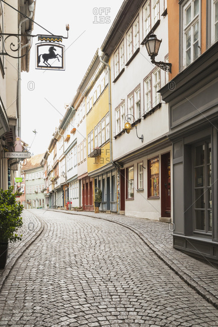 March 17, 2019: Empty cobble street amidst residential buildings in Erfurt- Germany