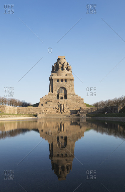 Lake of tears with reflection of Völkerschlachtdenkmal against clear blue sky- Saxony- Germany