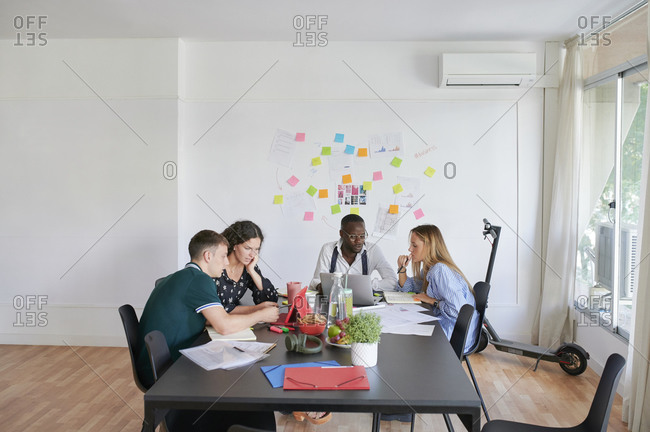 Young business people having a meeting in a modern office