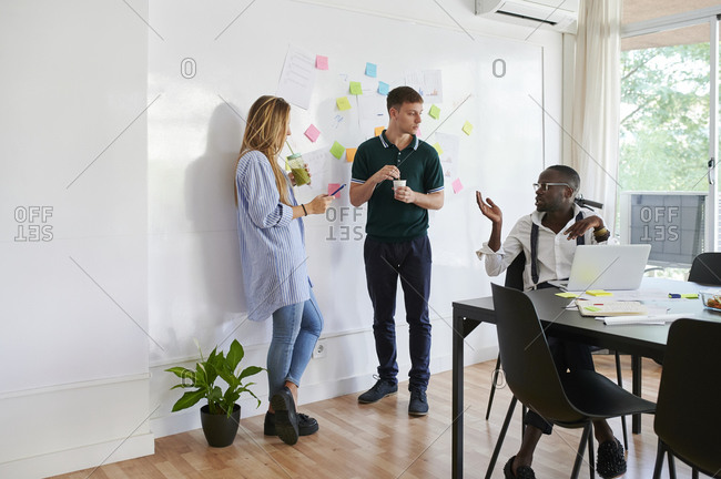 Young business people talking in a modern office