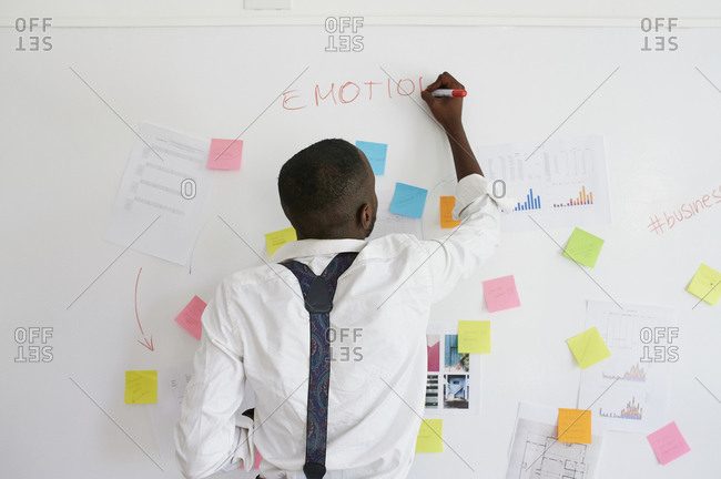 Young businessman working on a project in office