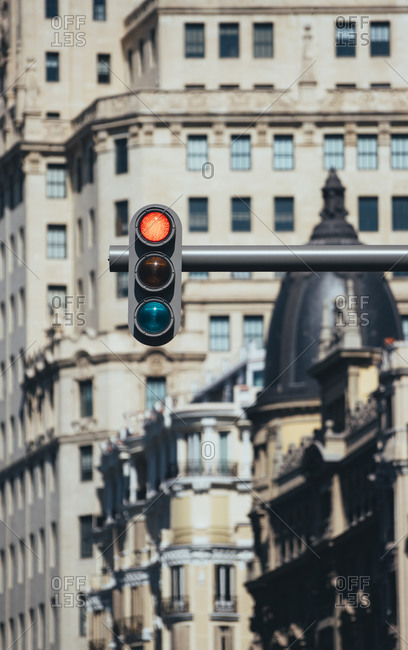 Low angle view of road signal against buildings in Madrid- Spain