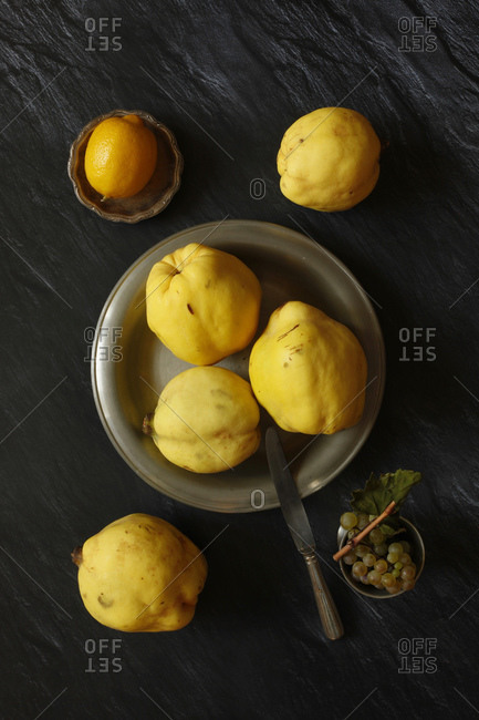 Still life with quinces- lemon and grapes