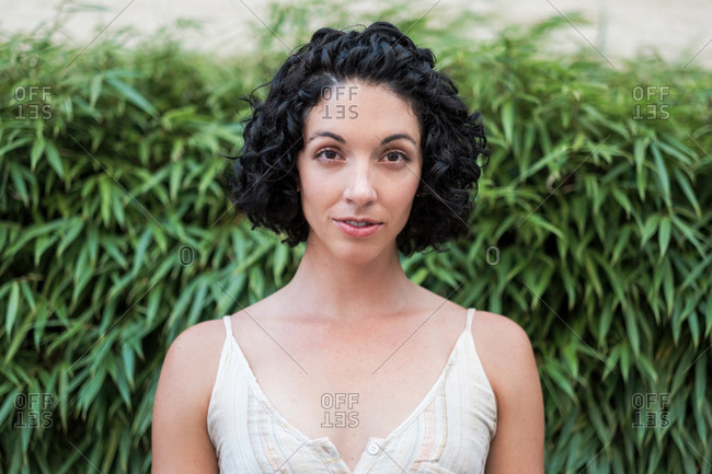 Portrait of a beautiful young woman with short curly hair