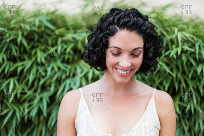 A beautiful young woman with short curly hair