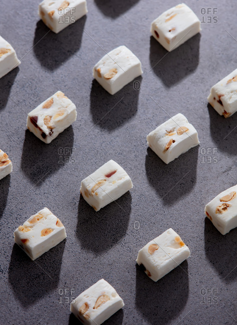 Traditional white candies with peanut on concrete surface