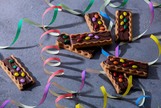 Cookies with dragee in chocolate and serpentine