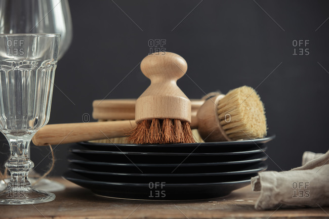 Eco-friendly wooden brushes for washing dishes and a plates