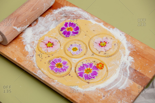 Dough with petals of a primula flower for a cookies
