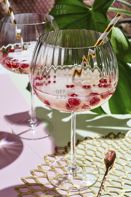 Glass of champagne with fresh berries