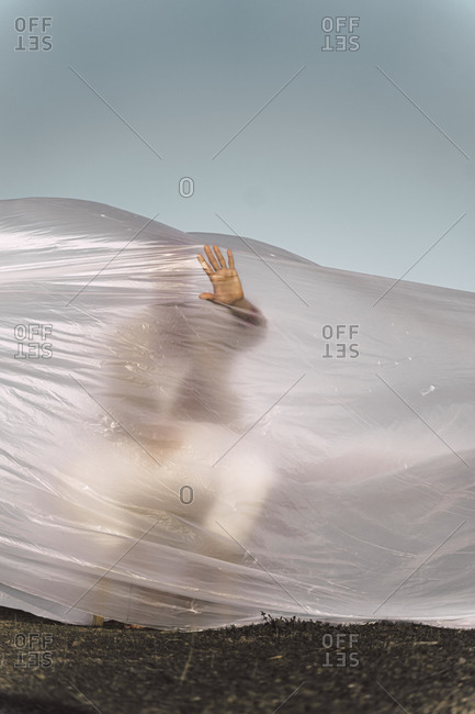 Man trapped in a plastic foil