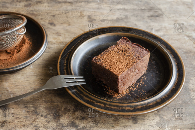 Plate with homemade gluten and sugar free brownie made with teff flour