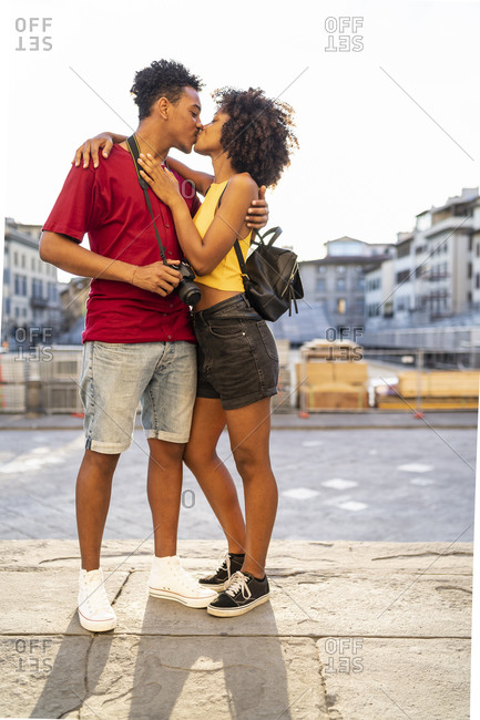Young couple kissing in the city- Florence- Italy