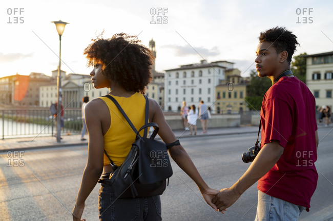 Young tourist couple exploring the city at sunset- Florence- Italy