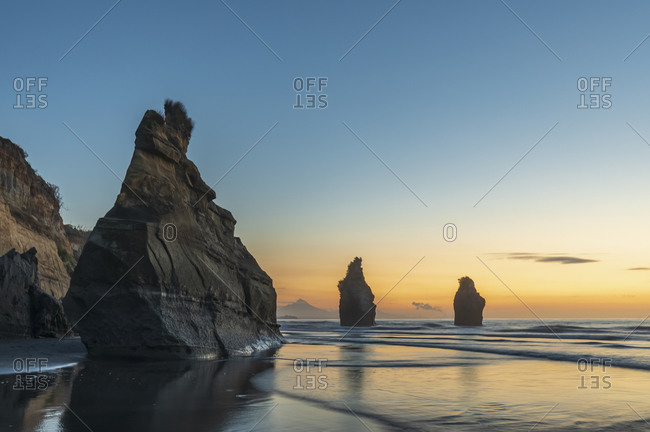 New Zealand- New Plymouth District- Tongaporutu- Three Sisters rock formation at dusk
