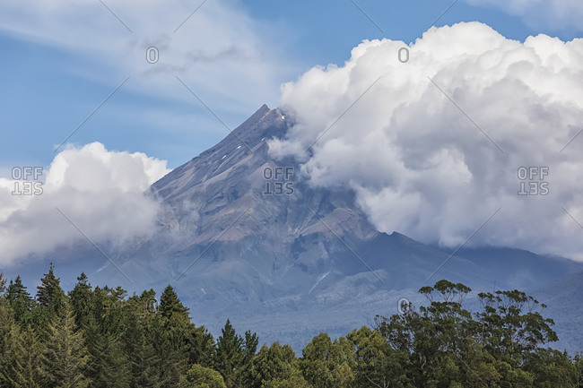 New Zealand- Scenic view of Mount Taranaki shrouded in clouds