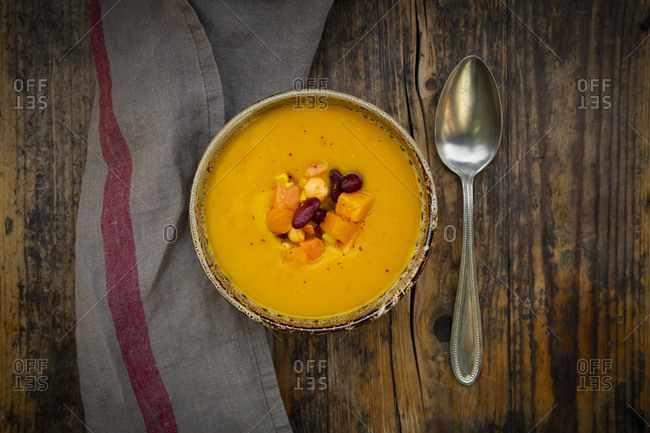 Bowl of pumpkin-sweet potato soup with corn and kidney beans