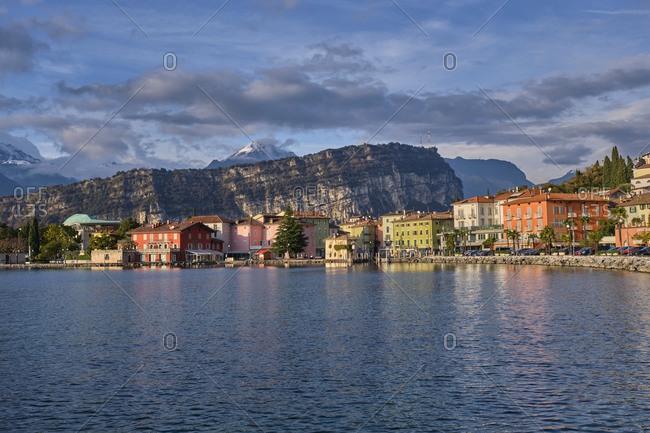 November 21, 2019: Italy- Trentino- Nago-Torbole- Coastal town on shore of Lake Garda with cliff in background