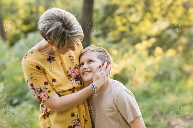 Happy mother together with her son in nature