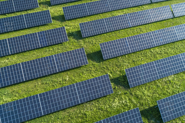 Bavaria- Germany- Rows of solar panels arranged on grass