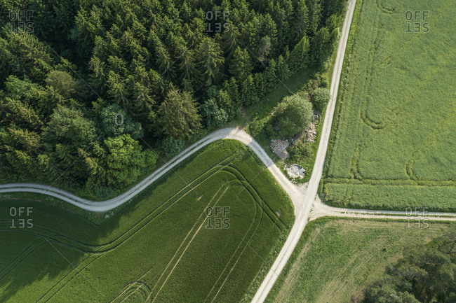 Germany- Bavaria- Aerial view of country roads intersecting between green countryside fields