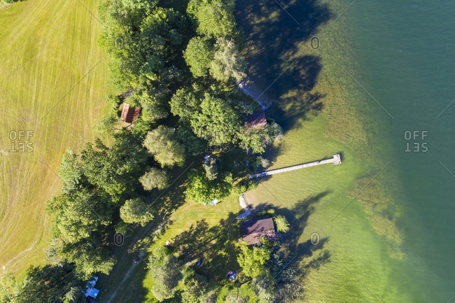 Germany- Bavaria- Bernried am Starnberger See- Aerial view of jetty on green shore of Lake Starnberg