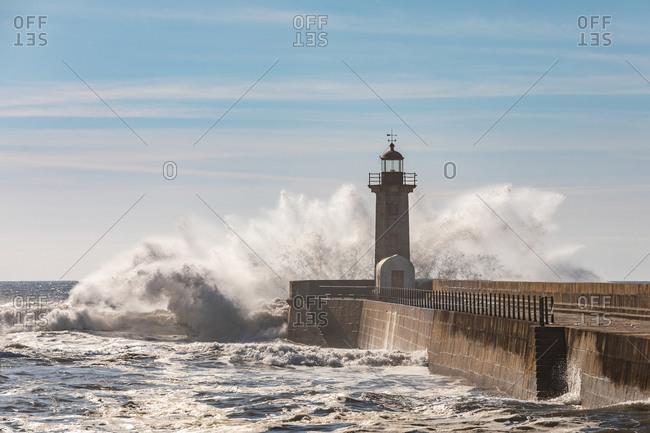 Portugal- Porto District- Porto- Waves splashing in front of Felgueiras Lighthouse