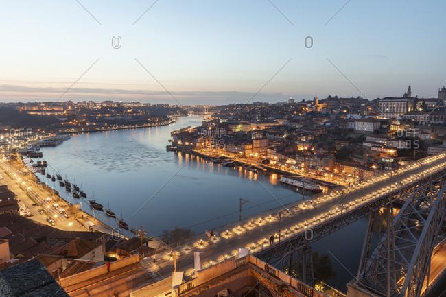 Portugal- Porto District- Porto- Aerial view of illuminated Dom Luis I Bridge at dusk