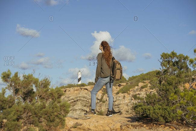 Redheaded young woman on a hiking trip- Ibiza- Spain