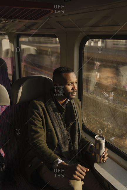 Stylish man traveling by train