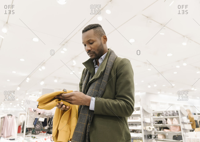Stylish man shopping in a clothes store