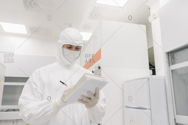 Scientist taking notes in laboratory