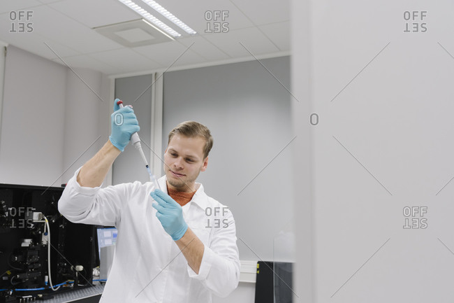 Scientist working with a pipette in laboratory