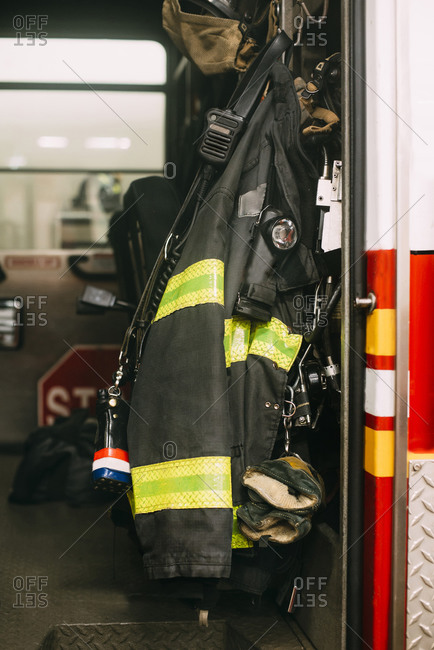 USA- New York- Fire protection suit hanging inside fire engine