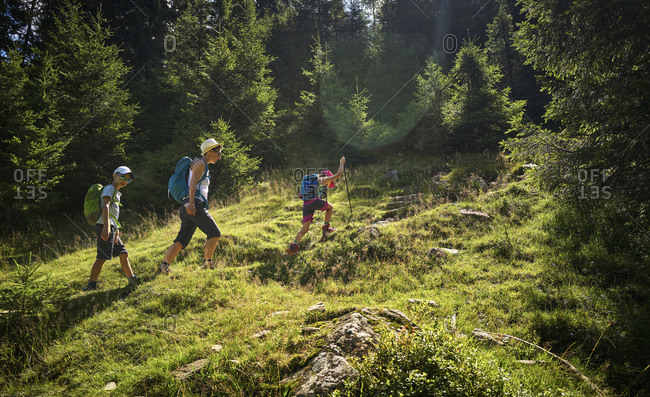Mother with two children hiking in alpine scenery- Passeier Valley- South Tyrol- Italy