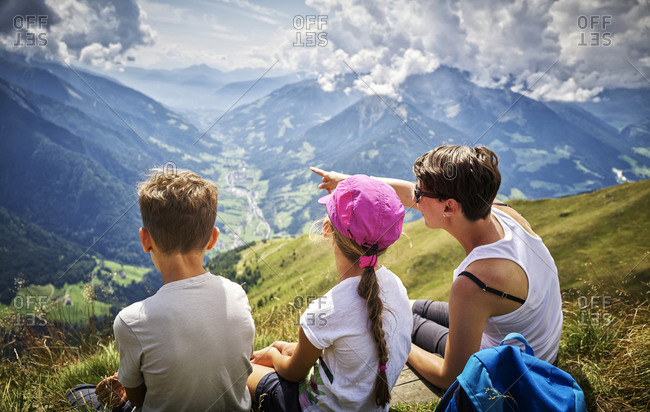 Mother with two children having a break from hiking in alpine scenery- Passeier Valley- South Tyrol- Italy