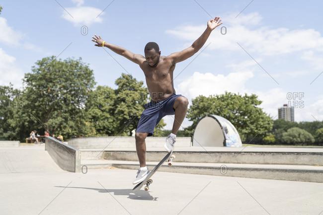 Man skating in skate park